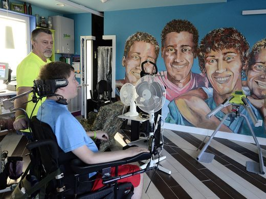 Quadriplegic with 'Extreme Home Makeover' defies odds, still improving