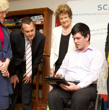Modified iPads being used by spinal injury patients