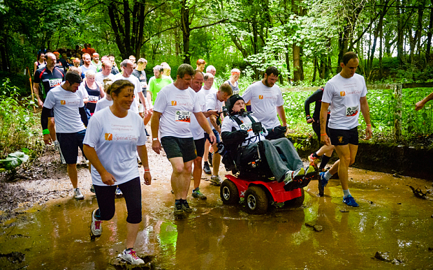 Tetraplegic student completes Tough Mudder Challenge in a wheelchair he controls with his chin