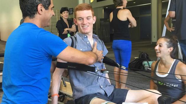 Swimmer determined to help others after injury left him paralyzed
