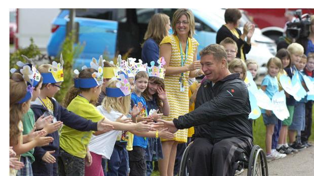 Rick Hansen greets students at Cardigan elementary